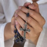 Hands Clasping Rosary Beads